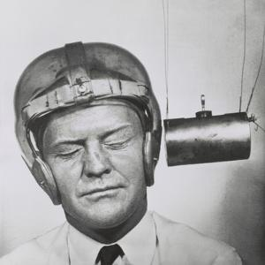 Pendulum Pounding a Plastic Helmet Worn for Testing to Improve Headgear for Football Players