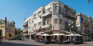 People at sidewalk cafe on the street, Nahalat Binyamin Street, White City, Tel Aviv, Israel