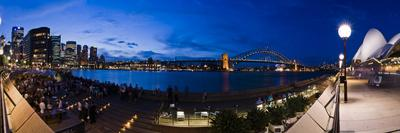 https://imgc.allpostersimages.com/img/posters/people-drinking-at-opera-house-bar-at-sydney-opera-house-harbour-bridge-and-skyline-australia_u-L-PHCONT0.jpg?p=0