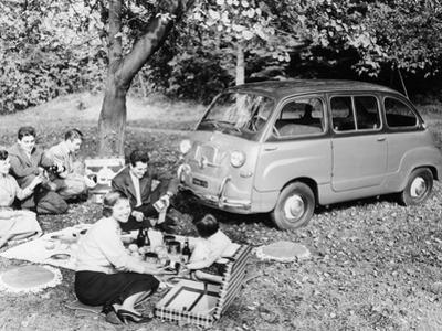 People Enjoying a Picnic Beside a 1956 Fiat 600 Multipla, (C1956)