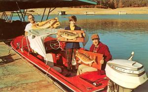 People in Motor Boat Holding Plaques with Fish