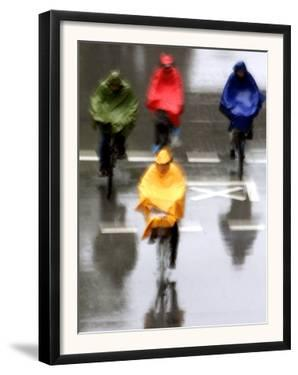 People Ride a Bicycles in the Heavy Rain