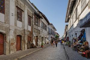 People walking on street, Calle Crisologo, Vigan, Ilocos Sur, Philippines