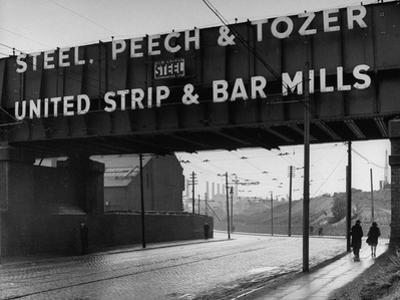 People Walking under Large Sign at Peech and Tozer Steel Plant