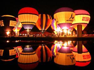 People Watch Hot Air Balloons as They Reflect off the Barigui Lake