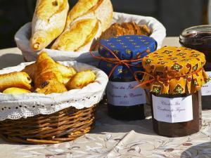 Wicker Basket with Croissants and Breads, Clos Des Iles, Le Brusc, Var, Cote d'Azur, France by Per Karlsson