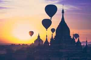 Amazing Misty Sunrise Colors and Balloons Silhouettes over Ancient Dhammayan Gyi Pagoda. Architectu by Perfect Lazybones