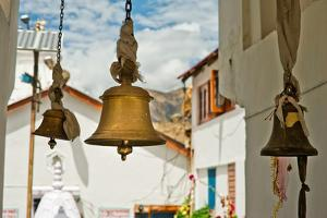 Bronze Bells in Front of Buddhist Temple. India by Perfect Lazybones