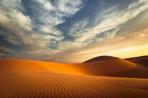 Global Warming Concept. Lonely Sand Dunes under Dramatic Evening Sunset Sky at Drought Desert Lands by Perfect Lazybones
