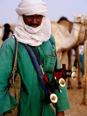 Tuareg Sword Salesman at Camel Market, Agadez, Niger by Pershouse Craig