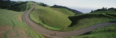 Person Cycling on the Road, Bolinas Ridge, Marin County, California, USA
