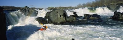 Person kayaking in a river, Great Falls, Potomac River, Maryland, USA