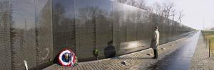 Person Standing in Front of a War Memorial, Vietnam Veterans Memorial, Washington D.C., USA