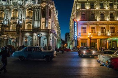 A bustling night scene in Havana, Cuba. by Pete McBride