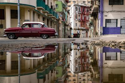 A Havana street with water on road to reveal reflections. by Pete McBride