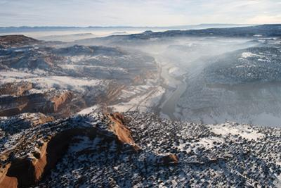 Fresh Snow and an Early Morning Fog Sit on Top of the Desert in Utah by Pete McBride