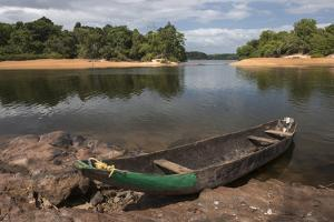 Dugout Canoe. Fairview, Iwokrama Reserve, Guyana by Pete Oxford