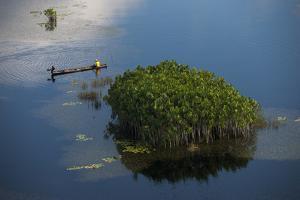 Fisherman in Conservancy. West Demerara Conservancy, West of Georgetown, Guyana by Pete Oxford