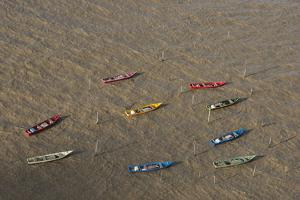 Fishing Boats. Atlantic Ocean, Shell Beach, North Guyana by Pete Oxford