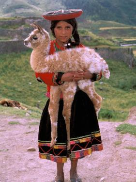 Indian Girl with Llama, Cusco, Peru by Pete Oxford