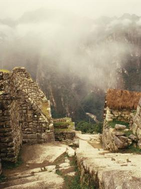 Looking Down Ancient Remains of Machu Picchu, Peru by Pete Oxford