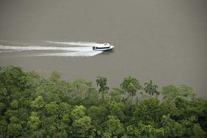 Speed Boat for Oil Industry, Napo River, Amazon Rainforest, Ecuador by Pete Oxford