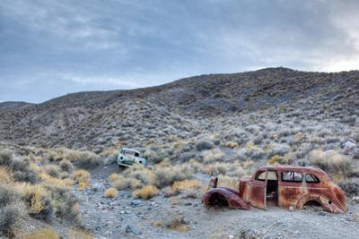 Remains of Old Vehicles in a Desert Landscape by Pete Ryan