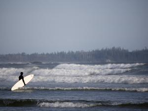 Surfer Walks Towards the Waves, Tofino, Vancouver Island, British Columbia, Canada by Pete Ryan