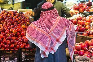 Arab Man Waerinf Keffiyeh Buying Apples in Market, Amman, Jordan by Peter Adams