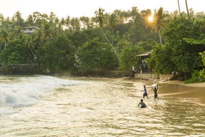 Boys playing in surf, Mirrisa beach, South coast, Sri Lanka by Peter Adams
