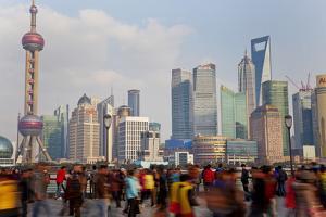Crowds on the Bund, Shanghai, China by Peter Adams