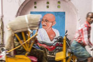 Cycle Rickshaw and Gandhi Mural, Chennai, (Madras), India by Peter Adams
