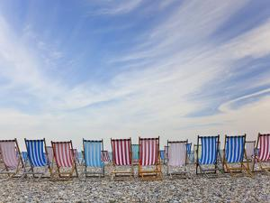 Deckchairs on Pebble Beach, Sidmouth, Devon, Uk by Peter Adams