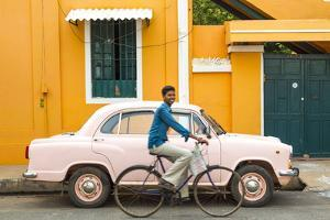 Male Cyclist and Ambassador Car, Pondicherry (Puducherry), Tamil Nadu, India by Peter Adams