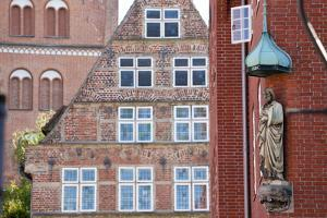 Statue on Wall, Lubeck, Germany by Peter Adams