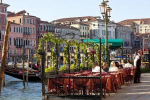 Tables Outside Restaurant by Grand Canal, Venice, Italy by Peter Adams