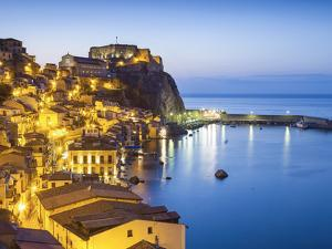 Town View at Dusk, With Castello Ruffo, Scilla, Calabria, Italy by Peter Adams
