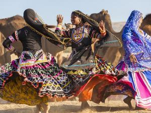 Women Dancers, Pushkar Camel Fair, Pushkar, Rajasthan State, India by Peter Adams