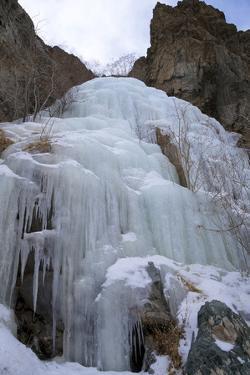 Frozen Waterfall in Rumbak Valley, Hemis National Park, Ladakh, India, Asia by Peter Barritt