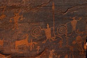 Horned Anthropomorphs Holding Shields, Utah Scenic Byway 279, Potash Road, Moab, Utah, USA by Peter Barritt