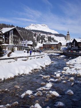 River and Village Church Lech, Near St. Anton Am Arlberg in Winter Snow, Austrian Alps by Peter Barritt