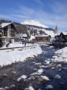 River and Village Church Lech, Near St. Anton Am Arlberg in Winter Snow, Austrian Alps by Peter Barritt
