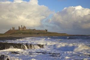Surf on Rocks, Dunstanburgh Castle, Northumberland, England, United Kingdom, Europe by Peter Barritt