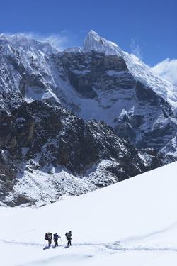 Trekkers Crossing Glacier on Cho La Pass by Peter Barritt
