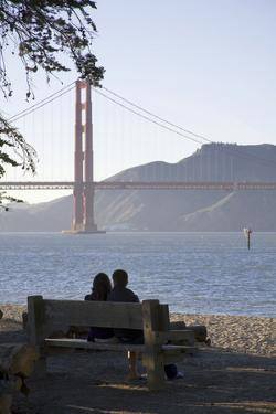 Couple with Golden Gate Bridge, San Francisco, California, USA by Peter Bennett