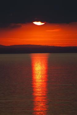 Sunset over Calm Sea. June 2010 by Peter Cairns