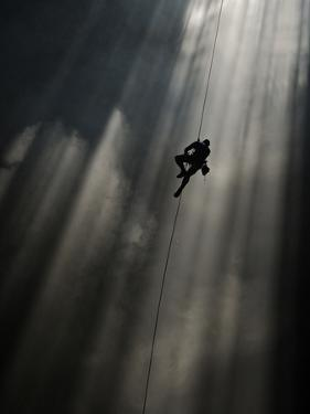 A Climber Ascends Loong Con by Peter Carsten