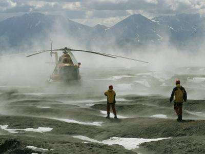 Members of the Volcanology Team Await the Helicopter in Gorely Volcano Crater by Peter Carsten
