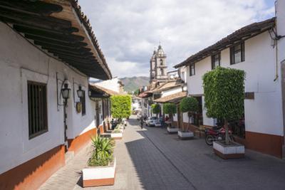 Typical street, in the distance the Parroquia de San Francisco de Assisi, Valle de Bravo, Mexico, N by Peter Groenendijk