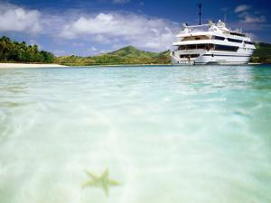Blue Lagoon Cruises Ship and Starfish in Water, Fiji by Peter Hendrie